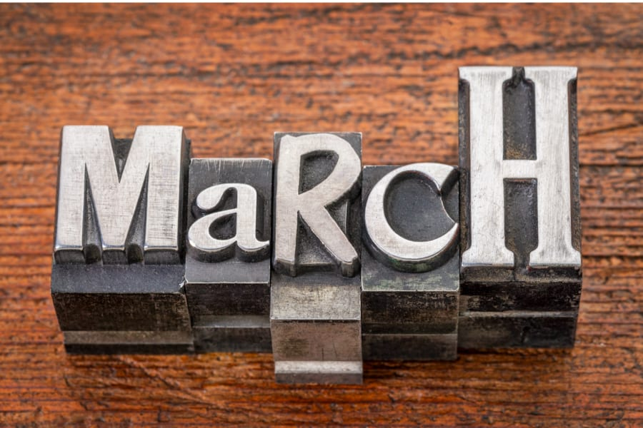 Vintage metal letters in March to look for stocks that pay dividends in March