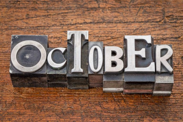 Vintage metal type characters for October to look at stocks that pay dividends in October